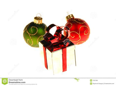 christmas gift box with ornaments around it stock images
