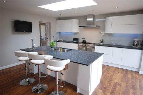 high gloss white  section kitchen  black granite