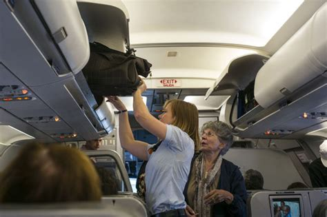 aircraft cabin luggage size united airlines to charge for luggage says new york