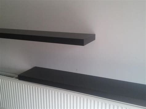 6 foot floating shelf two 6 foot black ikea floating shelves with fittings in