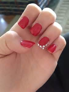 Got red nails for prom jems and sparkles were added