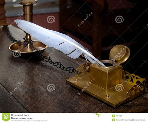 Ancient Inkwell And Feather Royalty Free Stock Photos