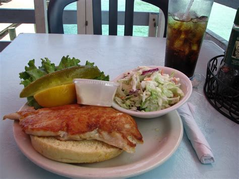 anna grouper maria island beach sandwich lunch bun hamburger tartar sandwhich lettuce tomato cole firm sauce fresh fish very