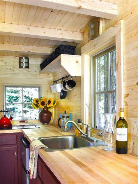 tiny house kitchen  large windows hgtv