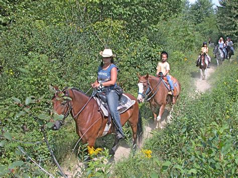 riding horseback trail farm mountains hampshire river stables nh ride vacations north conway usa cowboy property experience