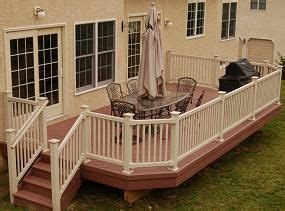 stained deck  white  cream railing trim house