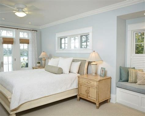 light blue beige white bedroom with light furniture