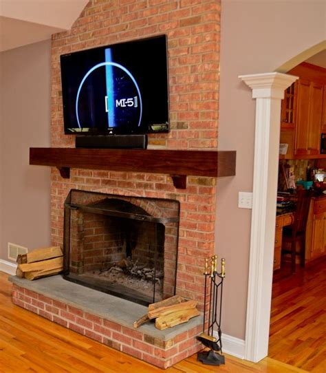 tv installation on brick fireplace in easton wires run