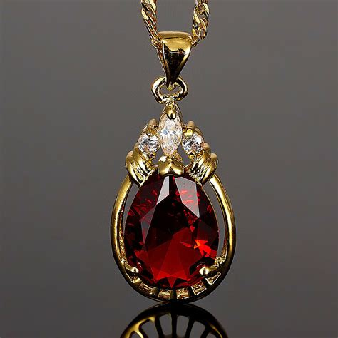 melina jewelry pear cut red ruby gold tone pendant