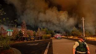 Thousands ordered to leave as Northern California fire rages while PG&E Cuts Power…