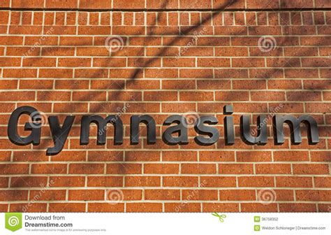 gymnasium sign  brick wall stock photography image