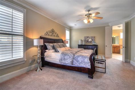 master bedroom with high ceiling crown molding in
