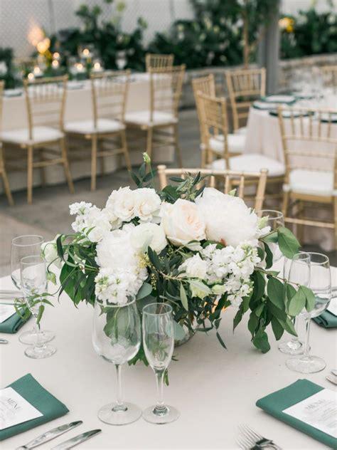 lush garden style centerpiece  foliage  white