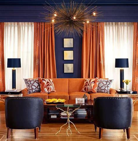 orange curtains and upholstery against grey walls is