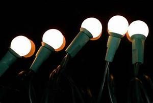 Christmas String Lights White Cord String Of 35 8mm Pearl White Globe Bulb Lights On Green