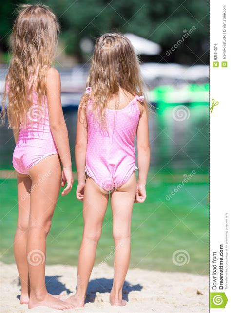 Adorable Little Girls During Summer Vacation Stock Photo
