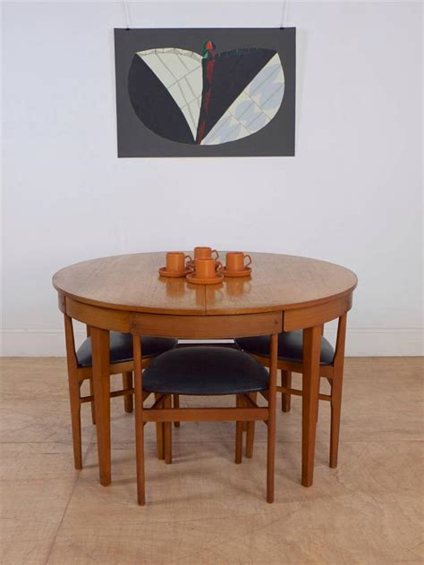 60 s extending teak dining table set of 4