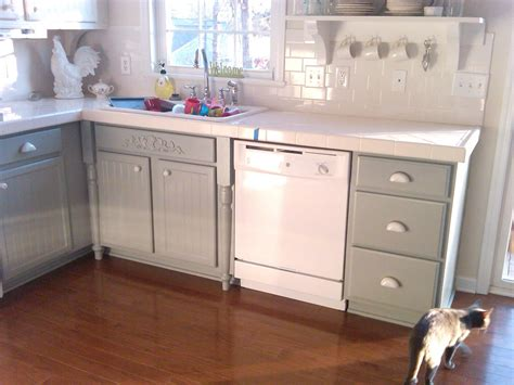 We sand, prime, paint, and finish with the recommended protective clear coat. Remodelaholic | Painting Oak Cabinets White and Gray