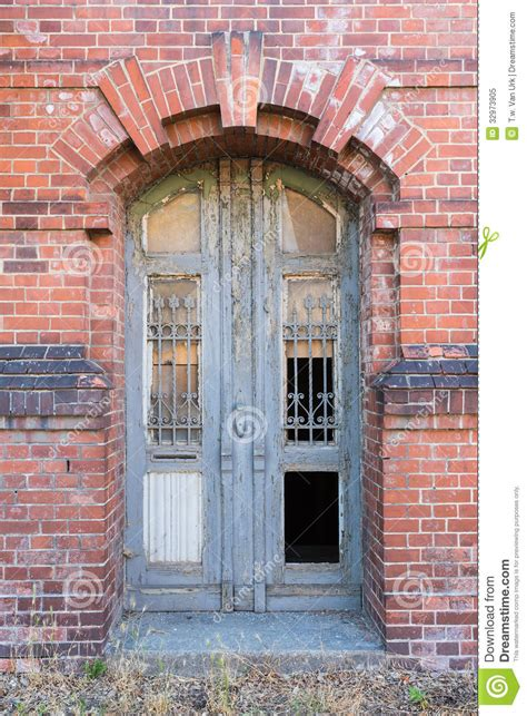 dilapidated door  masonry house front royalty  stock