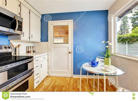 white kitchen cabinets with walls kitchen room with white cabinets blue walls and glass 2086