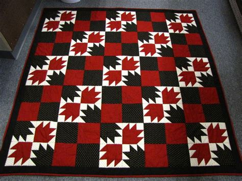 black  red bear paw quilt