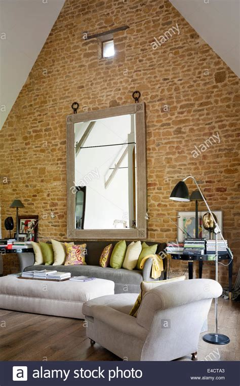 War For Your Living Room Stocks by Exposed Brick Wall In Living Room With Pitched Ceiling And