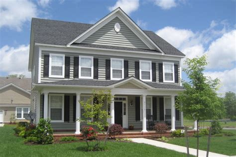 Popular Gray Paint Colors For Living Room by Classical Style House In Parkside Traditional Exterior