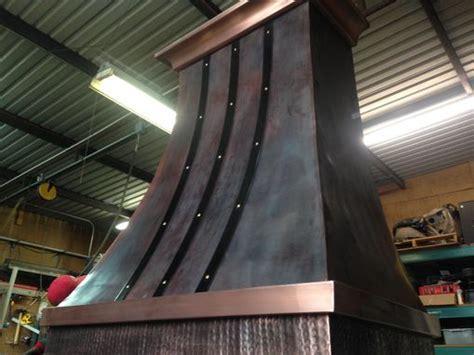 handmade copper range hood  iron straps  sawyer