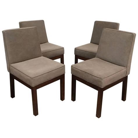 set of four parsons style dining chairs by keppel and