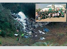 Brazilian team pose for photo in front of doomed jet which