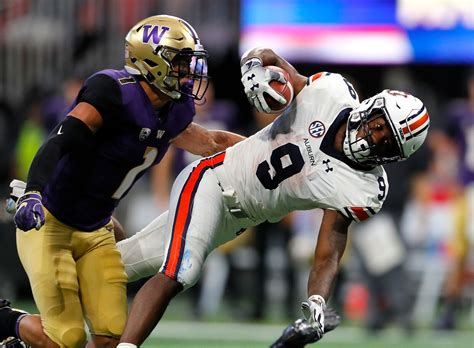 washington auburn huskies kam tigers martin football byron tackled teams getty america murphy