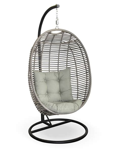 grey wicker hanging swing chair in egg shape completed by