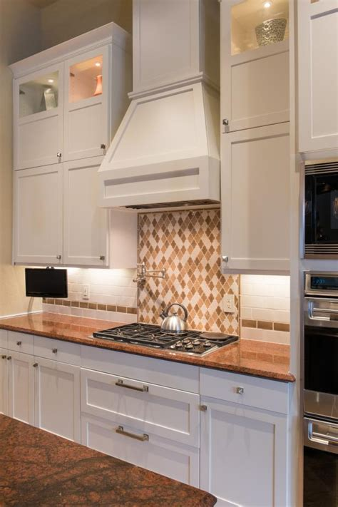 white shaker cabinets range hood  transitional kitchen