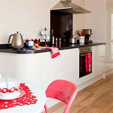 White Modern Kitchendiner With Red Accessories