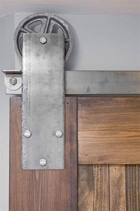 barn door hinges how to install sliding barn door hardware the handyman s