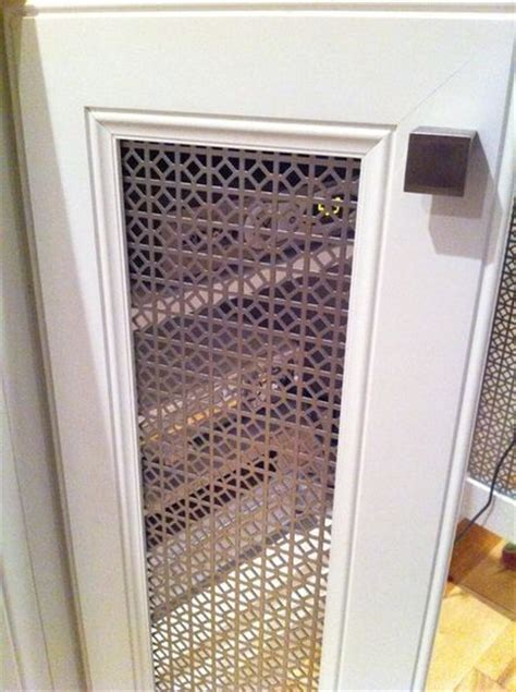 remove center doors  cabinet replace  perforated metal panels ventilation crafty home