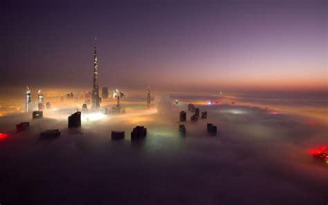 dubais fog   skyscraper city   clouds