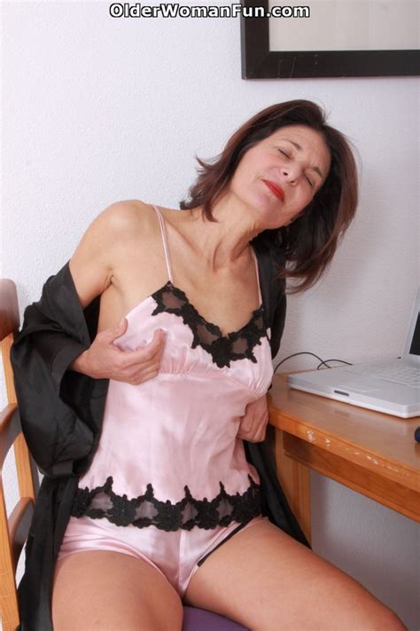 55 Year Old Gilf Emanuelle Works Her Hairy Pussy By