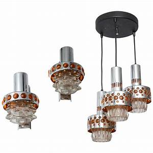 Hanging light chandelier with matching sconces at stdibs