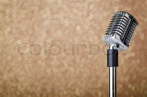 Old vintage microphone on background | Stock Photo | Colourbox