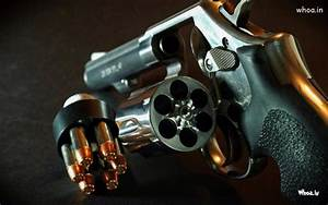 Gun With Set Of Bullet Wallpaper For Desktop