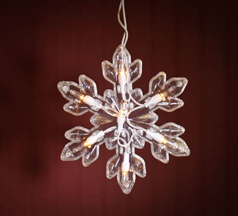 clear large snowflake bulb and white cord string lights