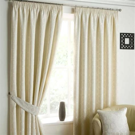 hanging pencil pleat curtains on a track curtain