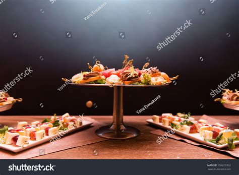 healthy canapes dinner canapes snacks shrimps bacon on dinner stock photo