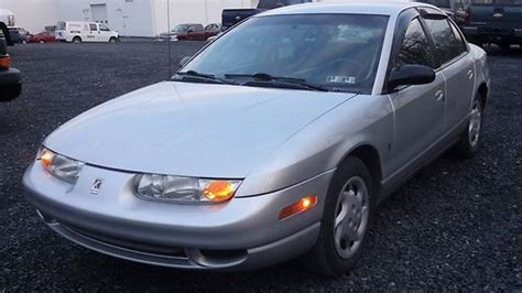 purchase   saturn sl base sedan  door