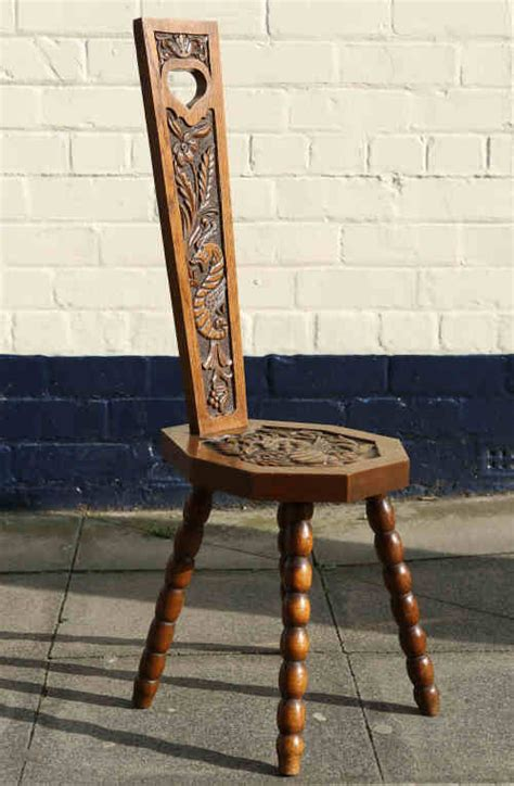 an arts crafts carved oak spinning chair the tapering