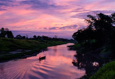 photo sunrise   peruvian amazon peru travel