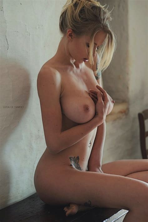 Dreamy blonde model is topless and hot