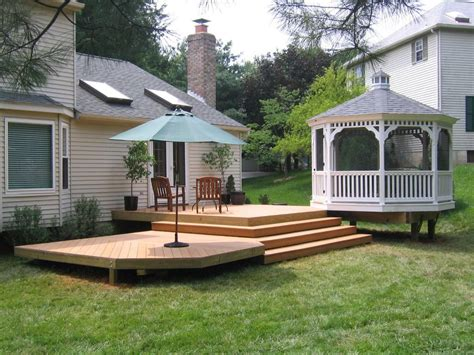 deck ideas for small yards raised deck ideas for small yard design with elegan white covered gazebo and green umbrella