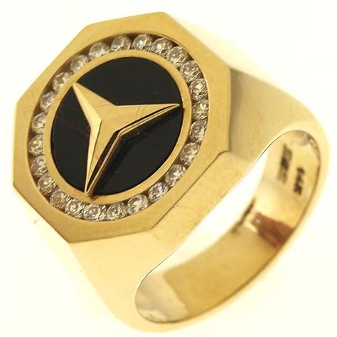 mercedes ring 11 3 gram 14kt yellow gold mercedes logo ring with black and colorless stones property room